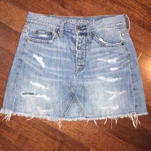 Women's destroyed denim mini